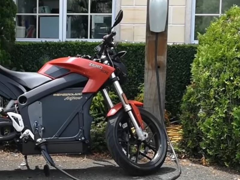 Electric ZERO motorcycle charging on a Tesla Station