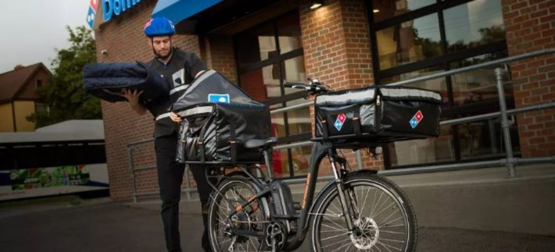 With electric bicycles pizza delivery by Domino's Pizza